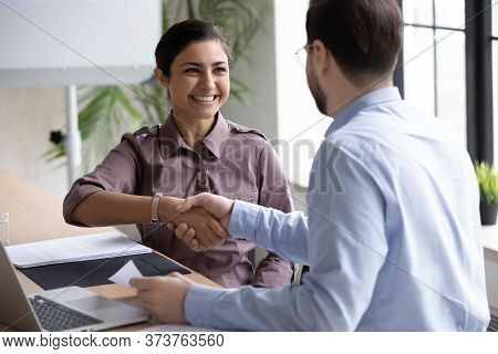 Recruiter Shaking Successful Smiling Indian Candidate Hand At Meeting