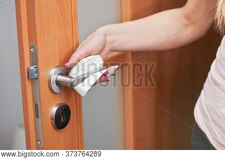 Hand Cleaning Or Holding Metal Door Handle With Paper Tissue Towel, Closeup Detail - Coronavirus Cov
