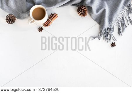 Autumn Cozy Composition With Gray Warm Blanket And Cup Of Coffee. Seasonal Autumnal Coziness With So