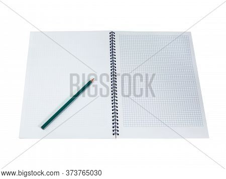 Green Pencil On White Notepad In The Cage With Blue Spiral Wire Binding. Isolated On White Backgroun