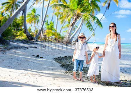 Beautiful family of mother and two kids on a deserted island