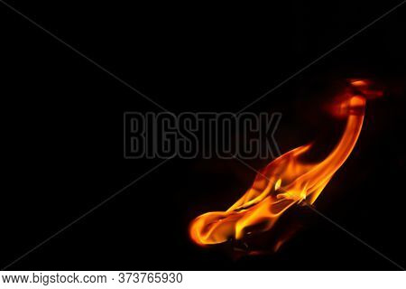 Flame Fire On Black Background, Burning And Blazing Flame.  Copy Space For Your Text