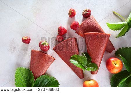 Natural Pastille Of Strawberries.dainty And Berries On A Light Background With Strawberry Leaves. Co