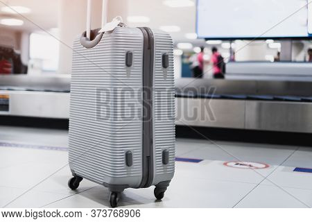 Silver Suitcases At Airport Departure Lounge Traveler In Airplane Terminal Near Blur Convey Belt Bac