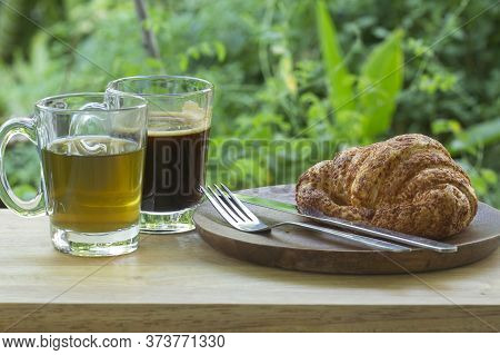 Thai Black Coffee And Hot Tea With Croissant Bread On  Wooden Bar Served In The Garden
