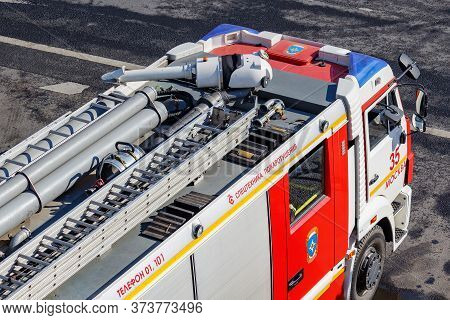 Moscow, Russia - May 01, 2019: Top View Of Parked Large Fire Truck On Moscow Street At Sunny Day