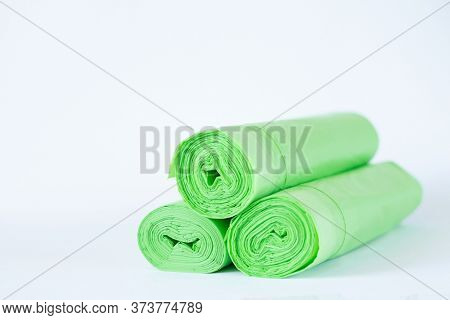 Three Rolls Of Biodegradable Eco Plastic Green Bags Isolated On White Background. Zero Waste Lifesty