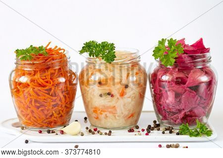 Fermented And Preserved Vegetarian Food Concept. Sauerkraut, Marinated Red Cabbage And Carrot In Ope