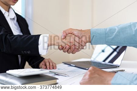 Financial accountants and marketers shaking hand to congratulate the double-digit real estate perfor