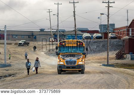 Clyde River, Baffin Island, Canada - August 20th, 2019: A School Yellow Bus On A Dirt Road In Clyde
