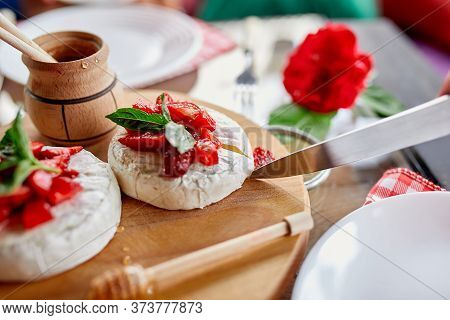 Man Cut Grilled Camembert Cheese With Strawberry, Honey And Basil Leaves, Delicatessen