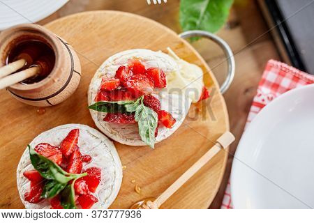 Grilled Camembert Cheese With Strawberry, Honey And Basil Leaves, Delicatessen