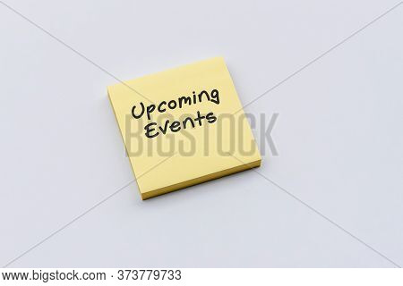 Upcoming Events Text On Sticky Paper Post Note