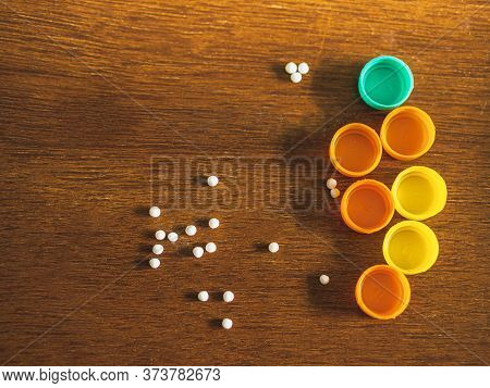 Bottles Filled With White Homeopathic Pills