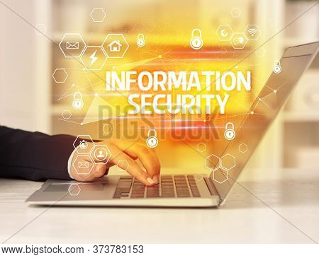 INFORMATION SECURITY inscription on laptop, internet security and data protection concept, blockchain and cybersecurity