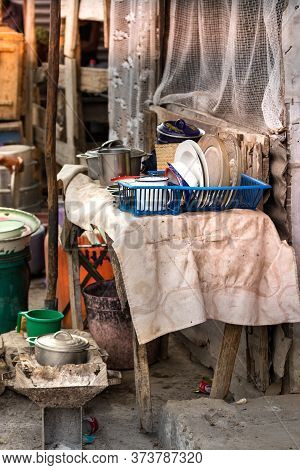 Rustic Charcoal Stoves And Cookware, Pots And Pans On A Table At The Local Market Of Toliara, Madaga