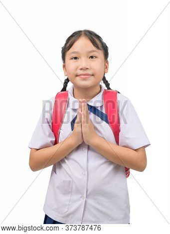 Asian Child In School Uniform And Backpack With Traditional Greeting Of Thailand On White Background