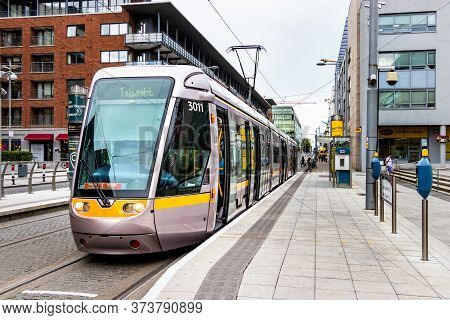 Dublin, Ireland - July 29th, 2019: The Tram Luas Direction Taliaght Stopped On A Station In Dublin,