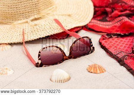 Vintage Summer Wicker Straw Beach Hat, Pareo And Sunglasses On The Seashore Of Catania, Sicily, Ital