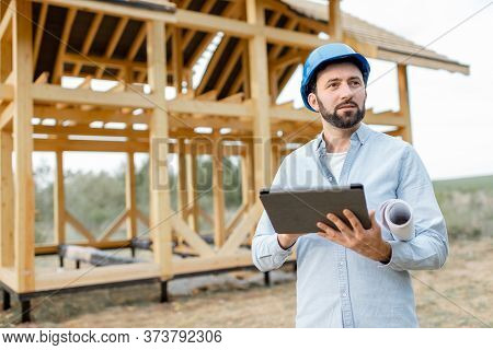 Architect Or Builder Using Digital Touchpad On The Construction Site Outdoors. Concept Of Building A