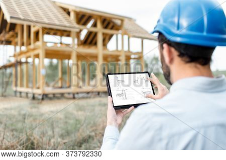 Architect Or Builder Using Digital Touchpad On The Construction Site Outdoors. Close-up On Screen Wi