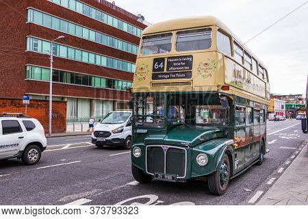 Dublin, Ireland - July 29th, 2019: A Vintage Double-decker Tea Time Bus Tour In Dublin, Ireland.