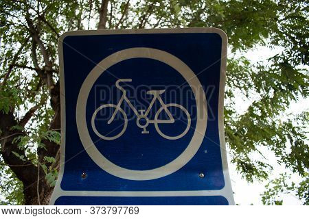 Blue Bicycle Sign On A Road In The Graden Close Up
