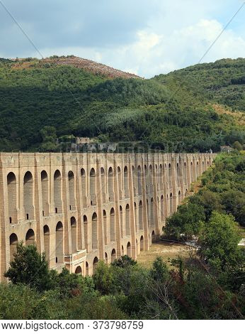 Imposing Structure Of The Aqueduct Called Carolino Aqueduct Near The Royal Palace Of Caserta In Sout
