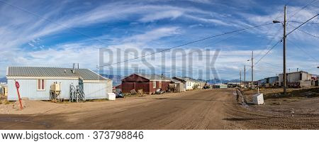 Pond Inlet, Baffin Island, Canada - August 23, 2019: Panoramic View Of Residential Wooden Houses On