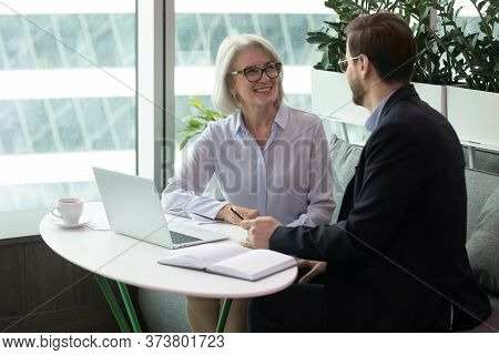 Female Boss Discusses Work Issues With Subordinate