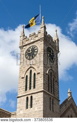 Parliament government clocktower with Barbadian flag is located on Broad Street in Bridgetown in Caribbean island Barbados