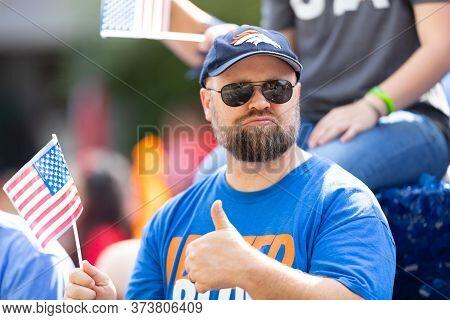 Arlington, Texas, Usa - July 4, 2019: Arlington 4th Of July Parade, Man Holding The National Flag, G