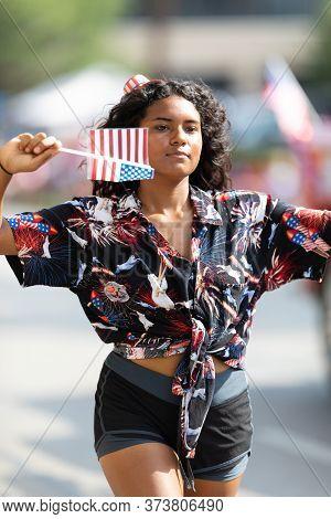 Arlington, Texas, Usa - July 4, 2019: Arlington 4th Of July Parade, Young Woman Walking Along The Pa