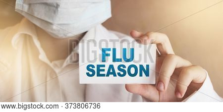 Doctor Holding A Card With Flu Season Medical Concept