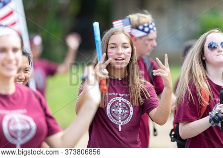 Arlington, Texas, Usa - July 4, 2019: Arlington 4th Of July Parade, Young Women Waving American Flag