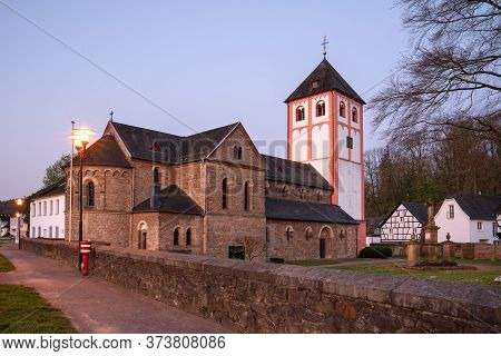 Center Of Village Odenthal With Parish Church And Old Buildings In Early Morning Light, Bergisches L