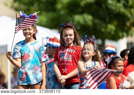 Arlington, Texas, Usa - July 4, 2019: Arlington 4th Of July Parade, Children On A Float, Waving Amer