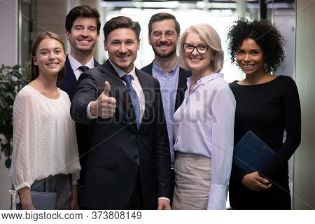 Successful Adult Business Man With Diverse Team Of Happy Workers