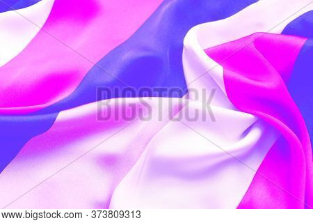 Purple-lilac Striped Satin Background. Silk Fabric With Pleats. Satin, Silk Or Satin Create A Beauti