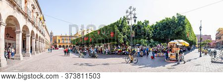 Celaya, Guanajuato, Mexico - November 24, 2019: View Of The Plaza De Armas, With Tourist And Locals