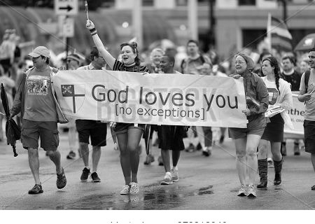 Cincinnati, Ohio, Usa - June 22, 2019: The Cincinnati Pride Parade, People Holding A Banner That Say