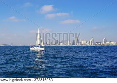 Sailing Yacht On The Background Of The Coastline Of The City Of Tel Aviv. Concept Of Water Tourism.
