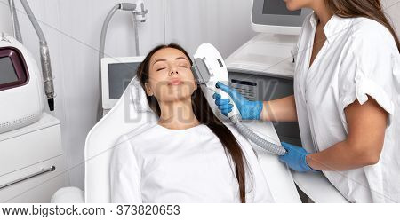 Elos Epilation Hair Removal Procedure On The Face Of A Woman. Beautician Doing Laser Rejuvenation On