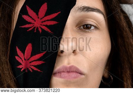 Serious Girl With Dreadlocks Covering Her Eyes With Cannabis Print