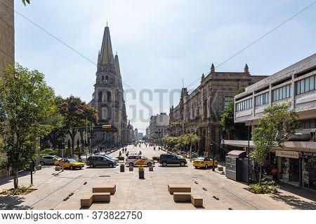 Guadalajara, Jalisco, Mexico - November 23, 2019: The View Down Fray Antonio Alcalde Avenue, With Th