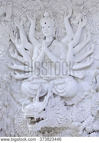 Chiang Rai, Thailand - November 15, 2019: Bas-relief With Bodhisattva And Dragon - Decoration Detail