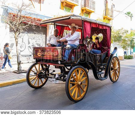 Guadalajara, Jalisco, Mexico - November 23, 2019: Old Carriage Transporting Tourists In The Streets