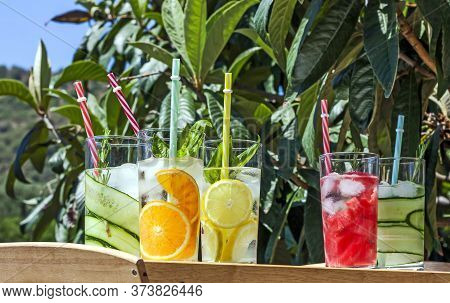 Iced Summer Drink. Refreshing Multicolored Alcol-free Cocktails In Glasses With Straws. Watermelon,