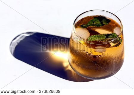 Iced Summer Drink. Two Glasses Of Refreshing Cold Green Tea With Mint Leaves And Ice Cubes On White