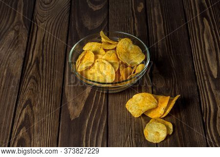 Chips In A Transparent Plate. Tasting Chips. Food For Beer. Chips On The Table.